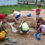 sand play during Community Child Care Center Summer Programs