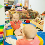 infant plays with mirror in Community Child Care Center Infant and Toddler Program