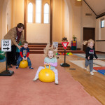 child bounces in Community Child Care Center Preschool Program