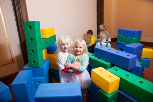 children play with large blocks at Community Child Care Center