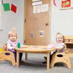 infant girls eat at Community Child Care Center