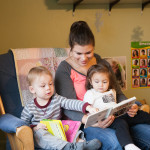Community Child Care Center staff member reads to toddlers