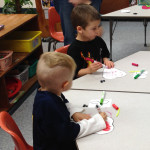 children color at Community Child Care Center