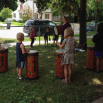 drum play during Community Child Care Center Summer Programs