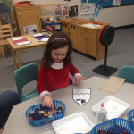 preschool child develops fine motor skills at Community Child Care Center