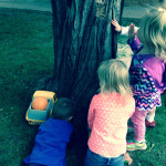 children inspect tree at Community Child Care Center